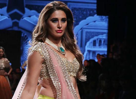 More comfortable in non-glamorous roles, says Nargis Fakhri!