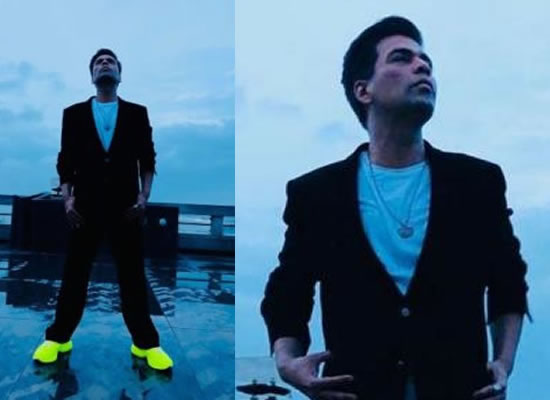 Karan Johar's monsoon look with a touch of neon!
