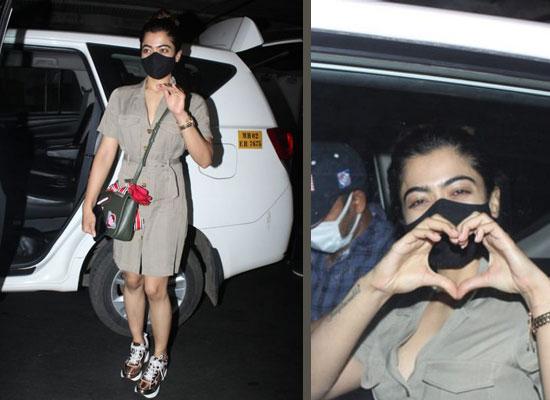 Rashmika Mandanna strikes a hand heart gesture at the airport!