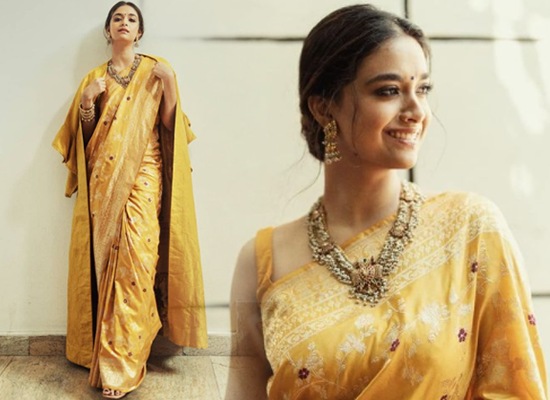 Keerthy Suresh's modern avatar in a yellow saree with a coat!