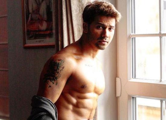 Varun Dhawan goes shirtless to exhibit his tattoo!